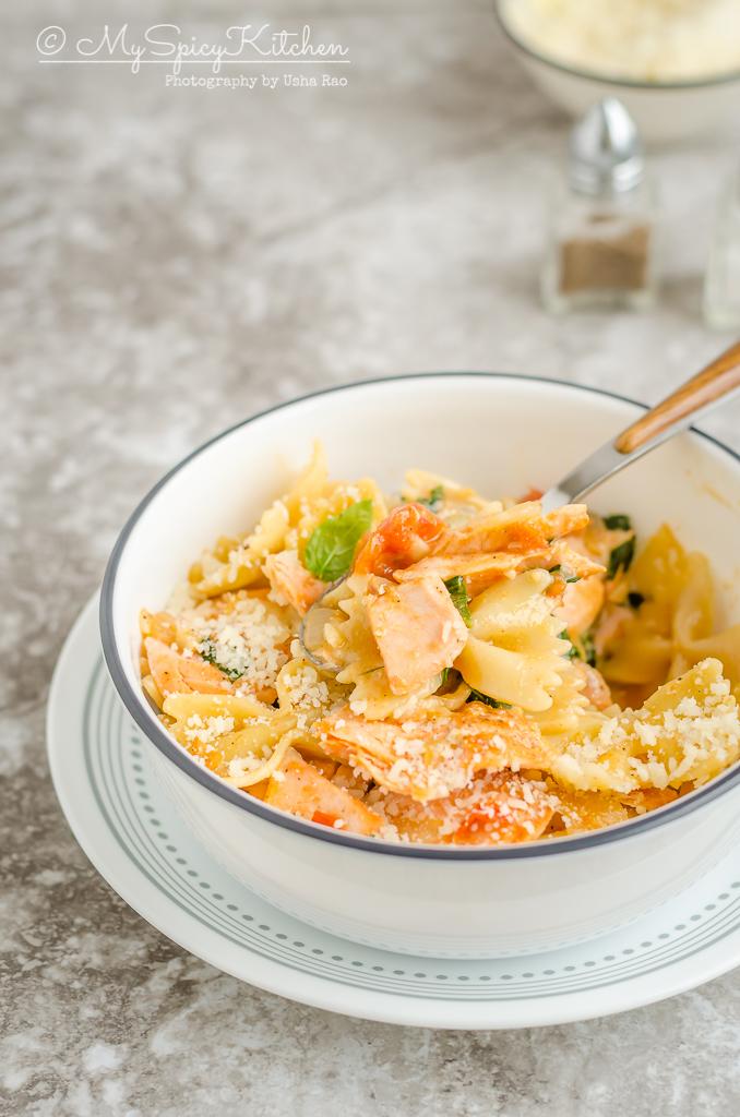 A bowl salmon farfalle pasta