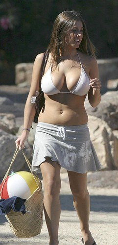 Lucy Pinder relaxing on the beach