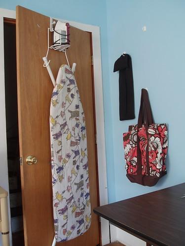 Ironing board rack space saving