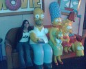 Gretel on the couch with with the Simpsons