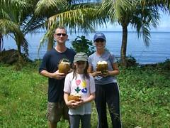 Enjoying coconuts, Kosrae