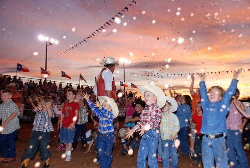 A Moment in Time Cowpoke Children Rodeo Bowie Texas Sunset Sky Cowboy Hats Blue Jeans Boots Smiles Flags