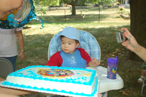 Micah inspects the cake.