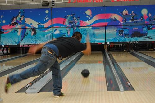Mark flings the ball down the lane