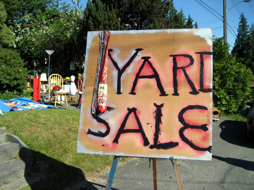Still life with yard sale sign and ties