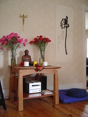 Buddha altar with crucifix