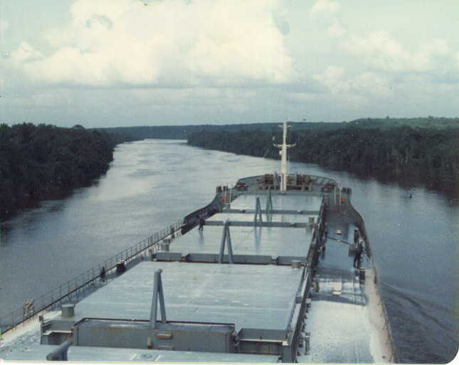 Bauxite Ship (Baron Belhaven) making her way north on the Demerara river towards Georgetown, Guyana