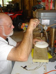 drilling the whole in the bottom of the saucer