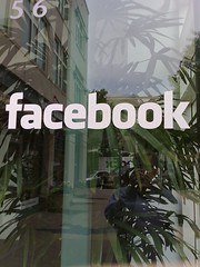 A window on front of Facebook offices in Palo Alto