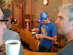 Kyle pours a latte