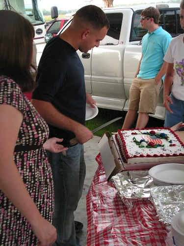 Kevin cuts the cake before shipping out