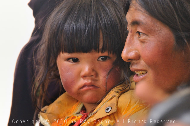 Tibetan father and child, Litang, Sichuan, China.