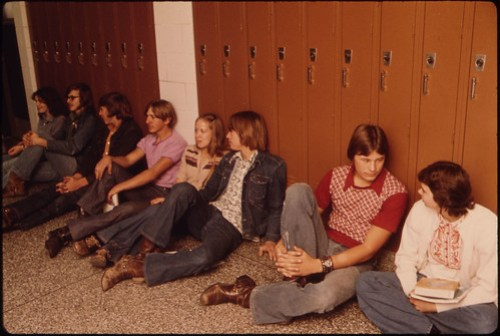 Students Resting in the Hall Against Their Lockers Waiting for Class at Senior High School in New Ulm, Minnesota...