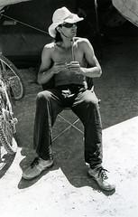 Michael rolls a cigarette