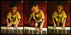 a four year old plays the piano
