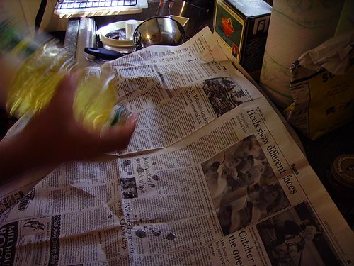 Oiling the newspaper