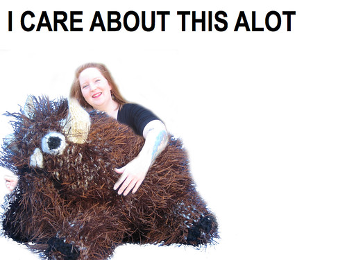 A picture of a woman holding a stuffed alot.