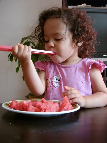 Mastering the chopsticks.