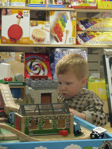 playing trains at the toy store