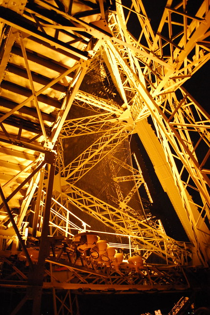 the illuminated interior space of the Eiffel Tower