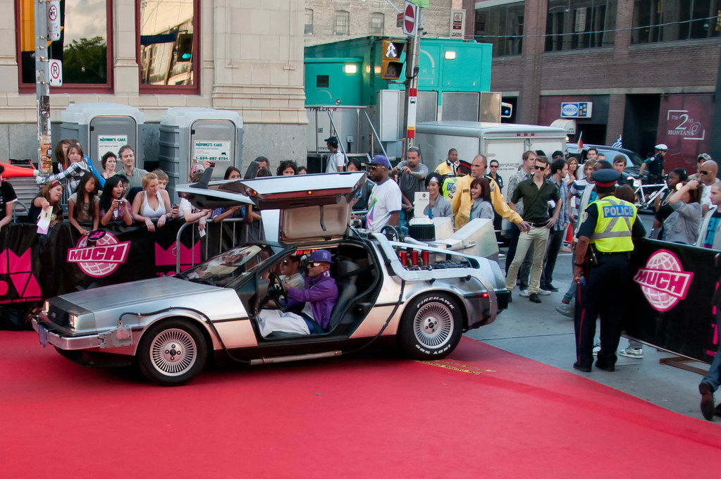 Karl Wolf arriving in a delorean