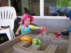 lola playing with sand box