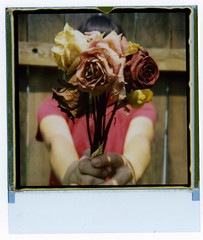 Girl Holding Dead Flowers