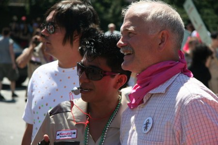 Jack Layton with a pink bandana is showing support for pride.