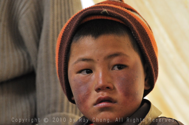 Tibetan boy, Litang, Sichuan, China.