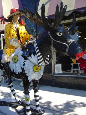 Floral moose with rider