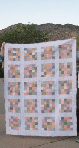 Shirt quilt against the Sandia Mountains