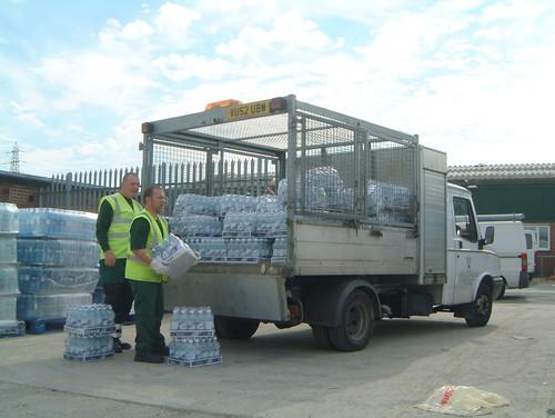 Cheltenham Borough Council staff loading up bottled water