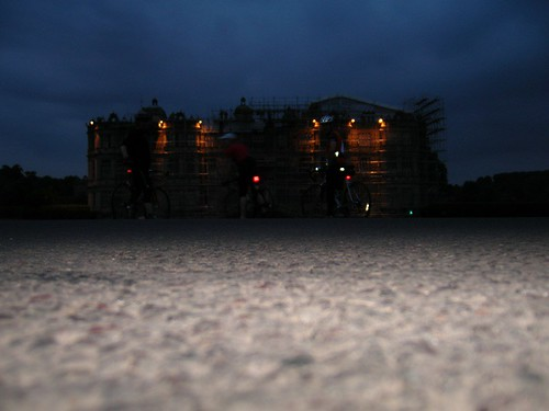Longleat House at dusk, three cyclists in front