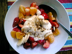 Fruit salad with yogurt, cinnamon, honey and nuts.