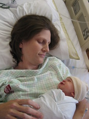 Photo of Katherine in the delivery room holding our baby girl