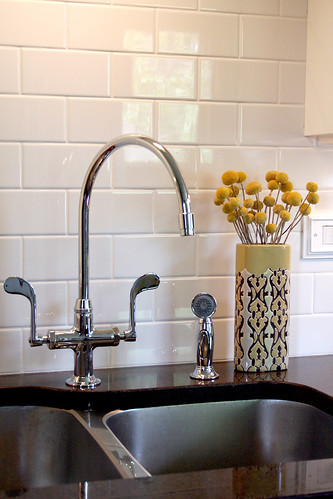 The faucet and backsplash by pinklovesbrown.
