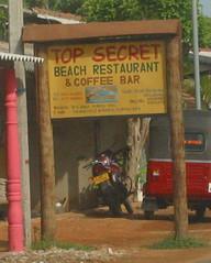 Top Secret Beach Restaurant & Coffee Bar sign