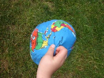 kid hand with globe