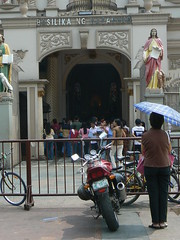 Lady Praying at the Entrance of Basilika Ng Nazareno