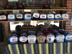the best collection of redneck hats ever - 'out of my mind. be back in 5 minutes', 'rebel and damn proud of it' etc. each only $3.50