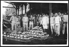 Some of the bakers with some newly baked bread