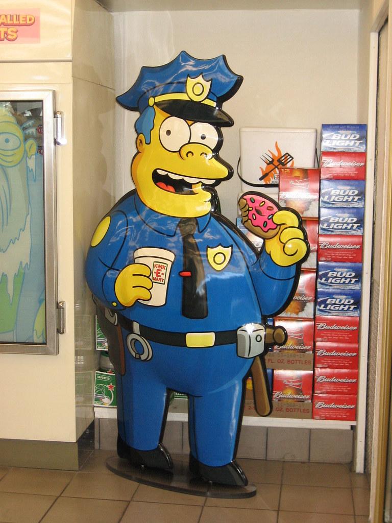 Chief Wiggum eating donuts at kwik e mart