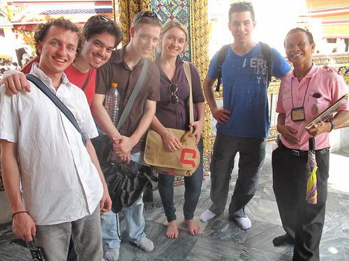Young IPO members barefoot at the royal palace