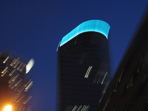Blue Light Special, downtown Minneapolis from the car window, photo © 2007 by QuoinMonkey. All rights reserved.
