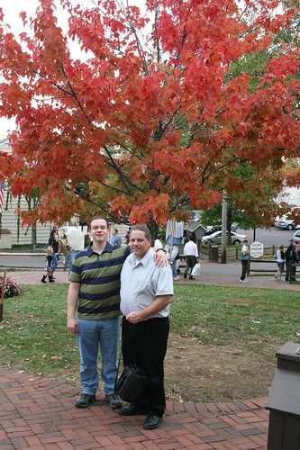 Sean and his dad Brian posing near a pretty tree