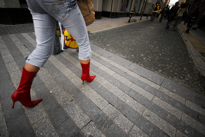 The lady's red boots