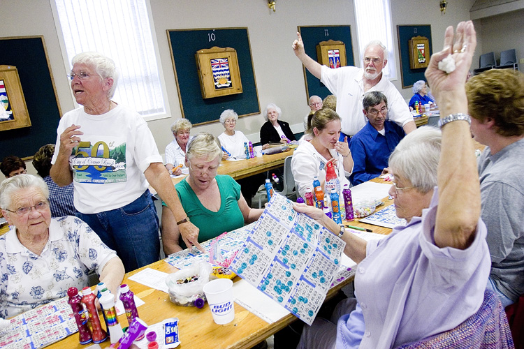 Joan McCullough and Dave Guyett are among the volunteers who help at bingo Tuesday nights.