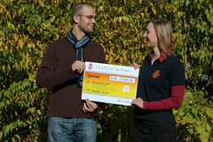 ICT4D.at chairman Florian Sturm receives the donation cheque from Leo Club St. Pölten chairwoman Maria Propst