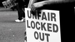 "Picket sign: ""Unfair, locked out"""