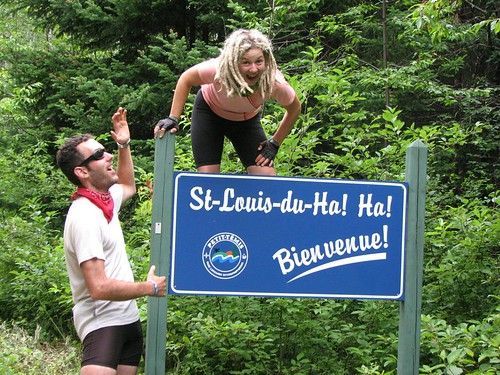 Some people posing with a Welcome to Saint-Louis-du-Ha! Ha! sign.